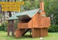 The Mansion Chicken Coop rear view open with text: easy access to your coop for cleaning and egg collection.