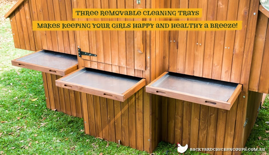 The Mansion Chicken Coop nesting boxes with removable cleaning trays with text: three removable cleaning trays makes keeping your girls happy and healthy a breeze.