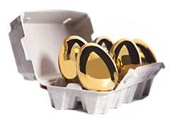 Golden chicken eggs in egg carton