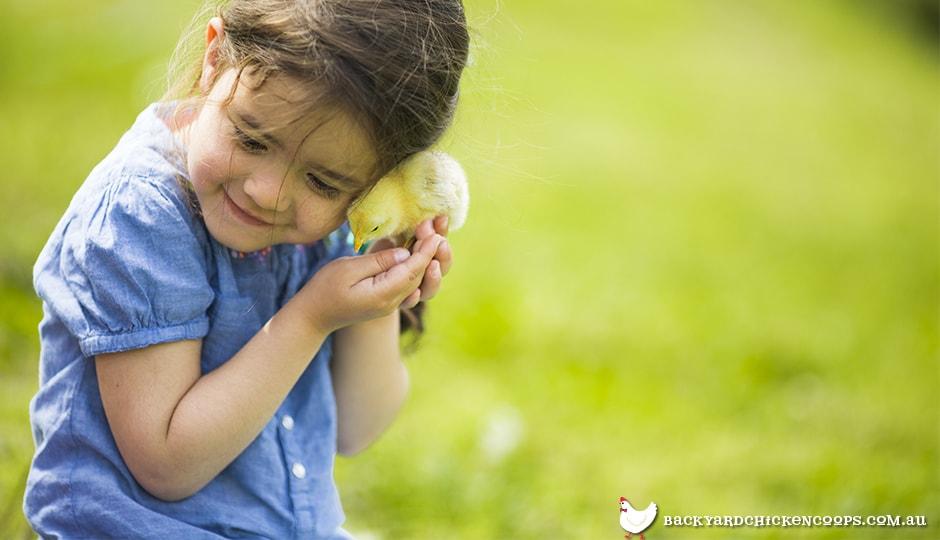 Girl hugging baby chick